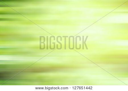 Abstract green motion blur background with bright light