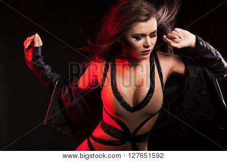 Sexy Woman With Blowing Hair And In Body Lingerie And Leather Jacket