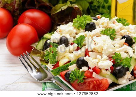 Vegetable salad with tomatoes, cucumbers, olives and feta cheese -bulgarian traditional summer salad.