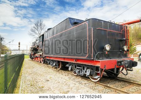 Old steam locomotive on rusty old rails