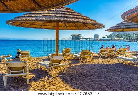 EILAT ISRAEL - FEBRUARY 23 2016: Winters in Eilat are very soft and comfortable for relaxing on the beach on February 23 in Eilat.