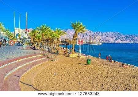 EILAT ISRAEL - FEBRUARY 23 2016: The North Beach of Eilat is one of the most popular beache of the resort on February 23 in Eilat.
