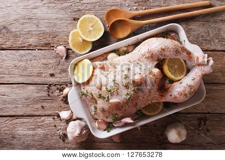 Raw Chicken Marinated With Garlic, Herbs, Spices And Lemon. Horizontal Top View