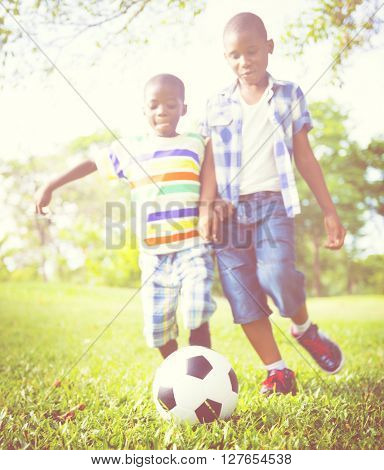 African Children Playing Exercise Football Concept