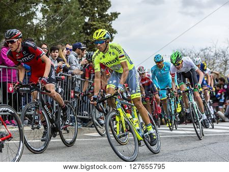 Barcelona Spain - March,27 2016: The cyclists Tejay van Garderen of BMC Team and Alberto Contador of Tinkoff Team riding in the peloton during Volta Ciclista a Catalunya on the top of Montjuic in Bracelona Spain on March 27 2016.