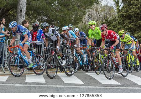 Barcelona Spain - March,27 2016: The peloton riding during Volta Ciclista a Catalunya on the top of Montjuic in Bracelona Spain on March 27 2016.