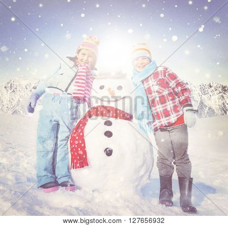 Little Girl and Boy Outdoors with Snowman Concept