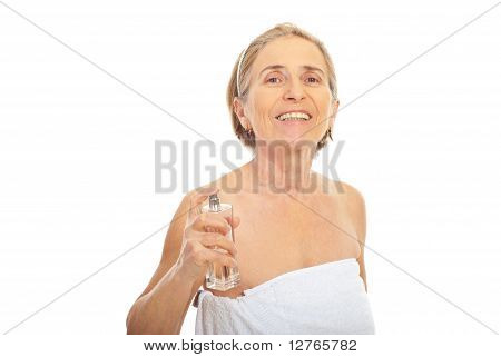 Senior Woman Applying Perfume