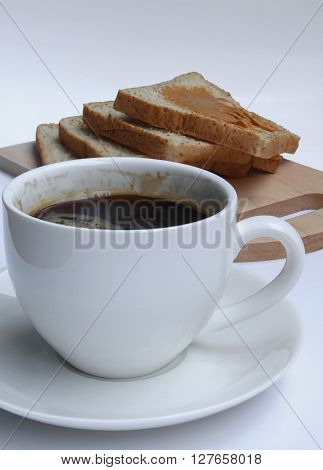 Coffee and peanut Butter bread on cutting board on the white background.