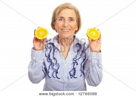 Healhty Senior Woman Holding Orange