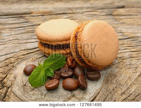 French macaroons with coffee beans in studio