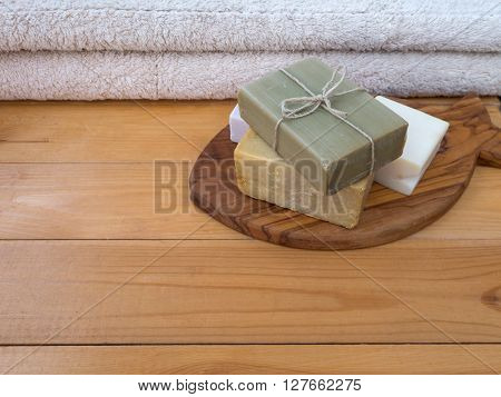 Herbal soap bar tied with jute rope on the olive tree fish shaped cutting board