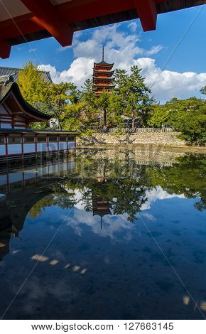 Itsukushima Shrine at Miyajima and famous five-tiered pagoda on the island Japan.