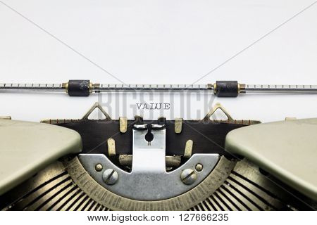 Close-up of word Value on typewriter sheet