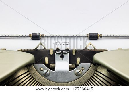 Close-up of word Taxes on typewriter sheet