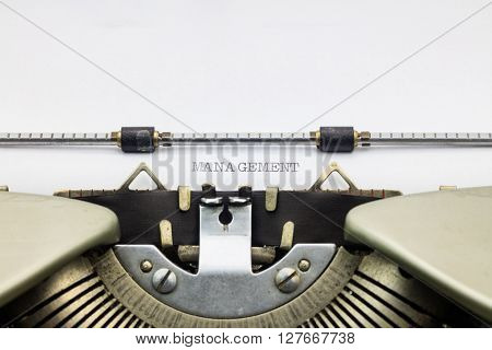 Close-up of word Management on typewriter sheet