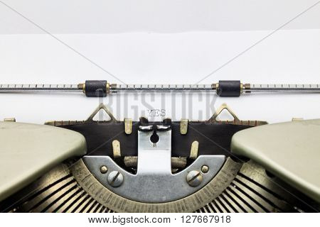 Close-up of word Yes on typewriter sheet