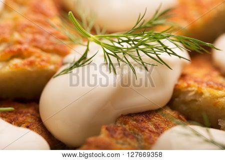 Traditional Irish potato pancakes with sour cream