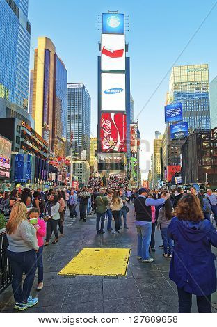 Pedestrians On 7Th Avenue And Broadway In Times Square