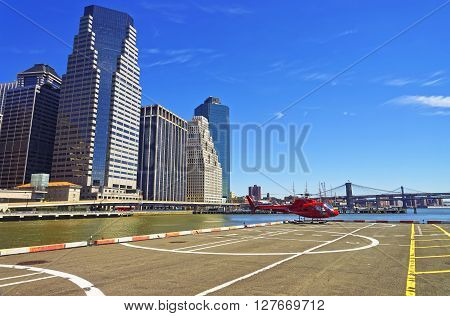 Red Helicopter On Helipad In Lower Manhattan New York