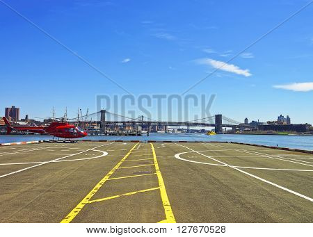 Red Helicopter On Helipad In Lower Manhattan Of New York