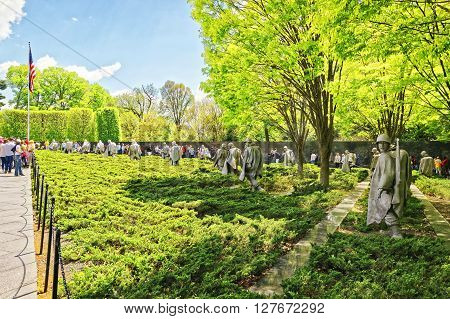 Washington DC USA - May 2 2015: Tourists and War Veterans and guardians of Honor Flight nonprofit organization at Korean War Veterans Memorial in West Potomac Park in the National Mall.