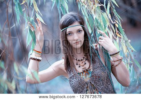 Portrait of hippie girl in blue leaves