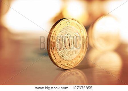 100 tenge (Kazakh money) lie at the edge of the table