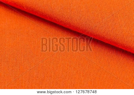 Orange weave material texture or background, close up