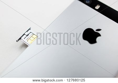 PARIS FRANCE - APR 21 2016: Installation of the new SIM card in the new Apple iPhone SE combining the updated processor 4K rear camera touch id retina display