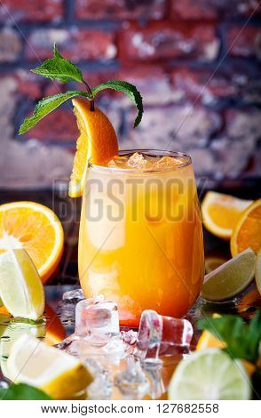 Tropical Orange Cocktail With Ice Cubes