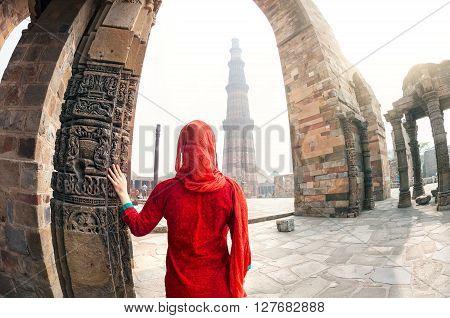 Woman Looking At Qutub Minar