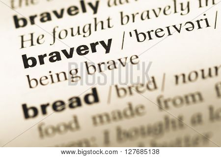Close Up Of Old English Dictionary Page With Word Bravery.