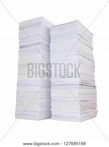 Two high stacks of paper isolated on white background