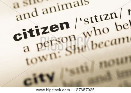 Close Up Of Old English Dictionary Page With Word Citizen.