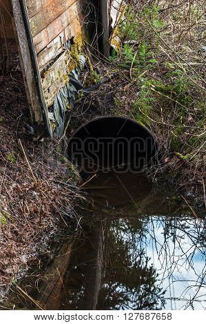 dirty water flow from rusty pipe in village