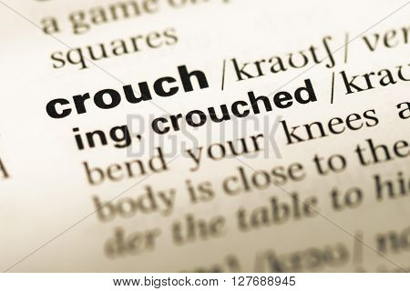 Close Up Of Old English Dictionary Page With Word Crouch.