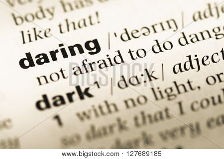 Close Up Of Old English Dictionary Page With Word Daring.