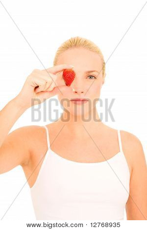 woman with a strawberry on eye on white background