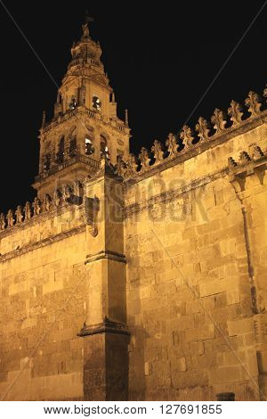 Wall and tower of the Mosque in Cordoba at night - Spain