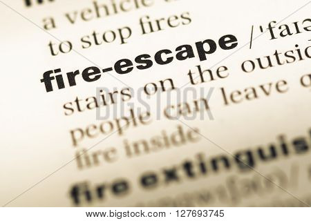 Close Up Of Old English Dictionary Page With Word Fire Escape.