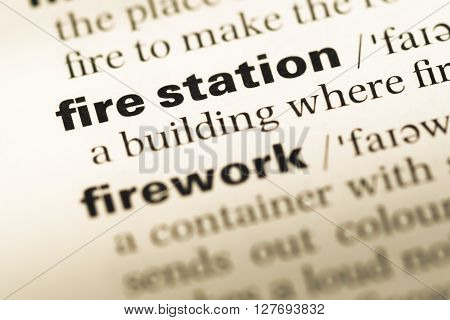 Close Up Of Old English Dictionary Page With Word Fire Station.