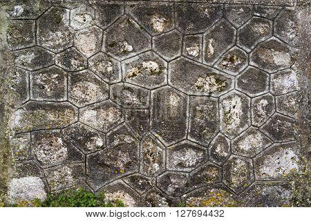 Plastered grey wall background with octagonal shapes