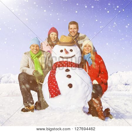 Group of friends posing with a snowman.