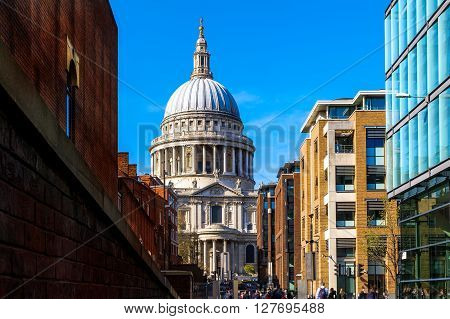 London, England - April 20, 2016 - St Paul's Cathedral tourists and local people walking on a sunny and cloudless afternoon.