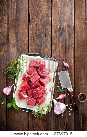 raw beef meat on a wooden table