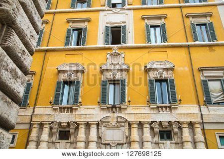 ROME, ITALY - APRIL 8, 2016: House facade in the centre of Rome, Mediterranean architecture