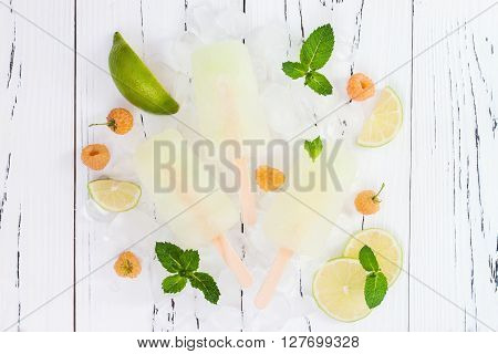 Refreshing mexican style ice pops - raspberry lime honeydew margarita paletas - popsicles. Top view overhead. Cinco de Mayo recipe