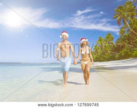 A couple relaxing on the beach on Christmas.