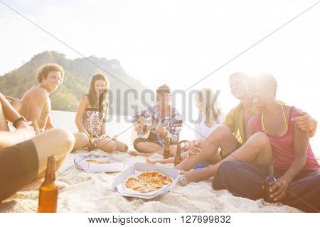 Group of friends having a summer beach party.